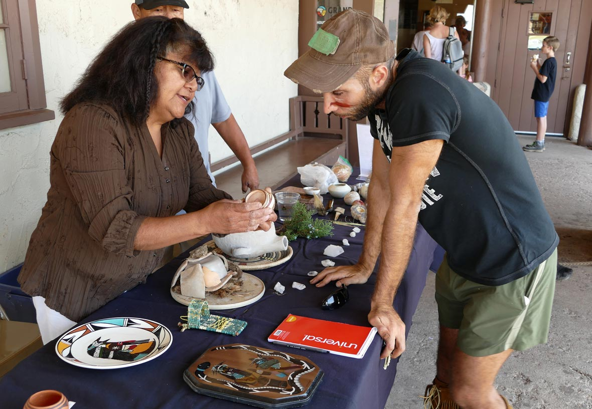 A woman gives a pottery demonstration outside of Desert View Trading Post at the Grand Canyon