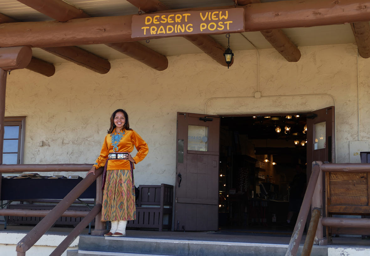 A woman stands outside of Desert View Trading Post at the Grand Canyon