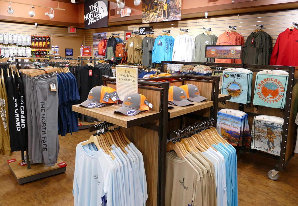 Sales floor at Grand Canyon Outfitters featuring hats, t-shirts, and sweatpants