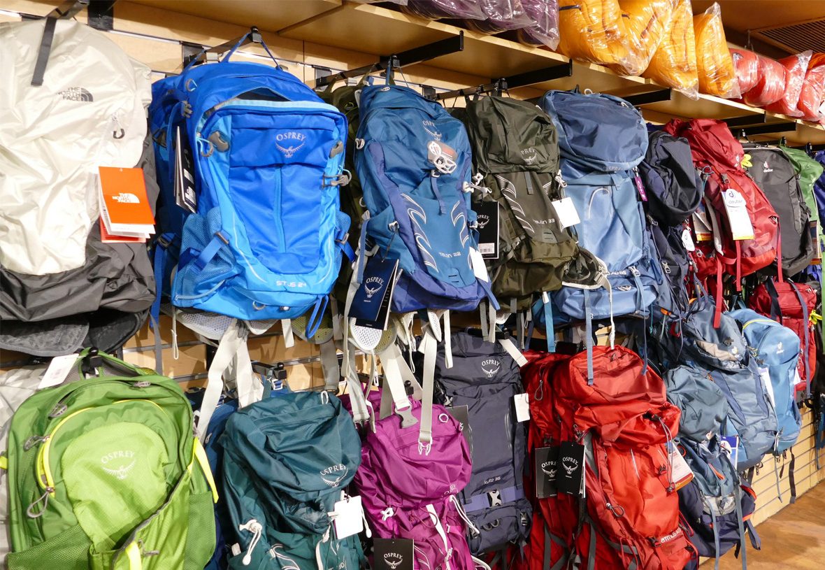 Backpacks hanging on a wall at Grand Canyon Outfitters