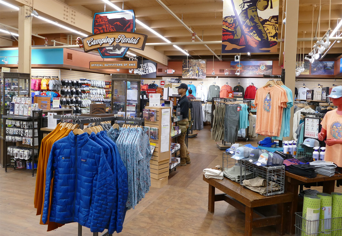 Wide view of the sales floor at Grand Canyon Outfitters featuring a Camping Rental sign hanging above the checkout counter