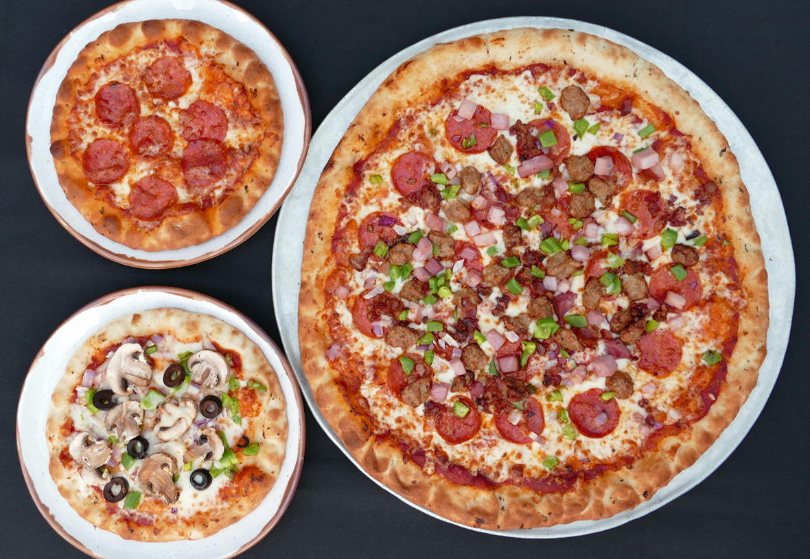 Overhead view of three pizzas