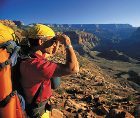 A hiker gazes out at the Grand Canyon