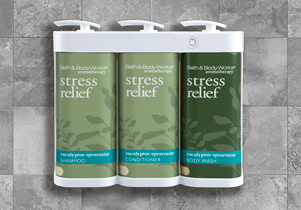 Bath and Body Works Eucalyptus Spearmint Stress Relief shampoo, conditioner, and bodywash affixed to a shower wall